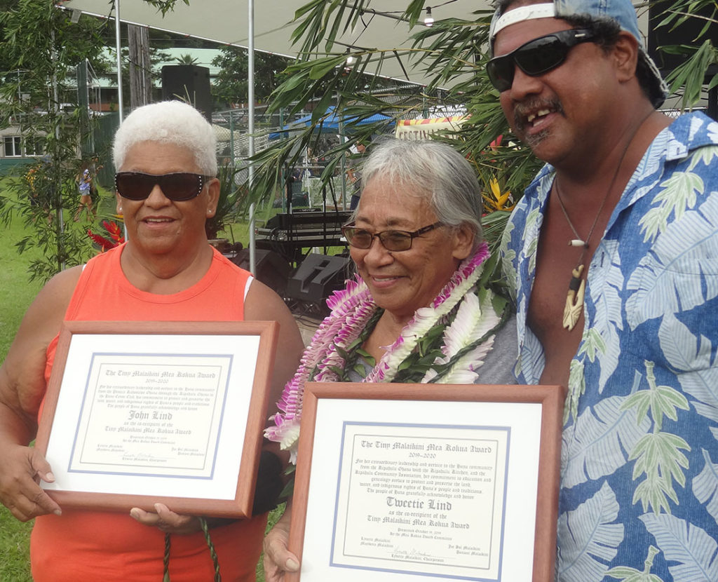Lynette Malaikini (from left), Tweetie Lind and Joe Sol Malaikini (Tiny and Lynette's son) are shown at the award presentation. John Lind was unavailable for the photo. -- WARD MARDFIN photo